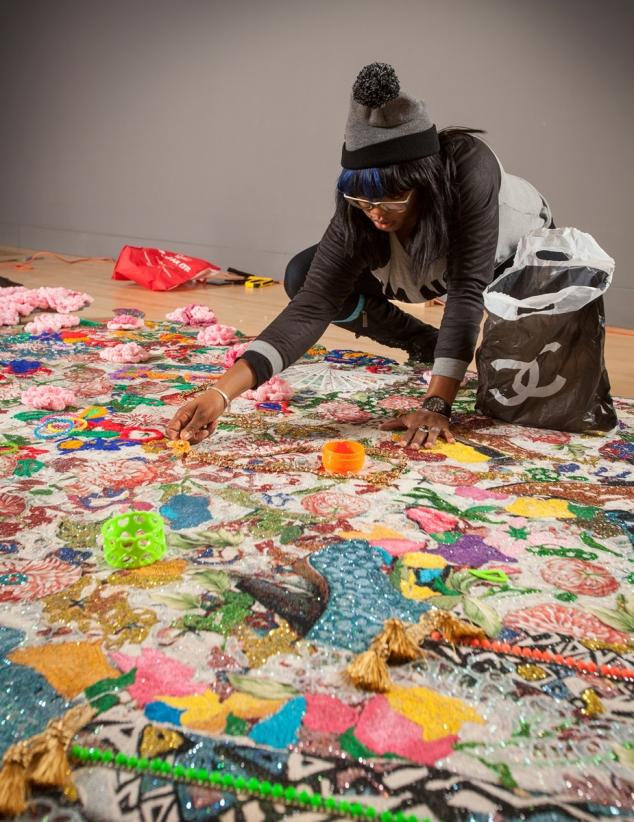 Ebony G. Patterson installing the exhibition Ebony G. Patterson: Dead Treez at the John Michael Kohler Arts Center, 2015