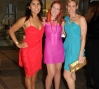 Cecily Carson and friends pose in the MAD lobby in their fluorescent attire before entering the FLUORESCENTBALL.