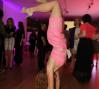 A partygoer enjoys some gymnastics at the FLUORESCENTBALL.