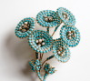 Maison Gripoix (circa 2000), France: Floral brooch. Simulated turquoise stones, simulated pearls, gold plated. © Pablo Esteva