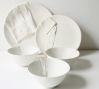 Dressed for Dinner, slip cast ceramic plates and bowls, 2010.