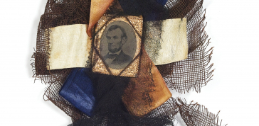 Artist Unknown, Mourning Badge with Portrait of Abraham Lincoln, 1865: tintype, gingham, black ribbons; Collection of Daile Kaplan; Photo credit: Matthew Starr
