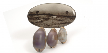 Bettina Speckner, Untitled (brooch), 2004: Artist's photograph enameled on silver, cowrie shells, amethysts; Courtesy of a private collection; Photo credit: Bettina Speckner