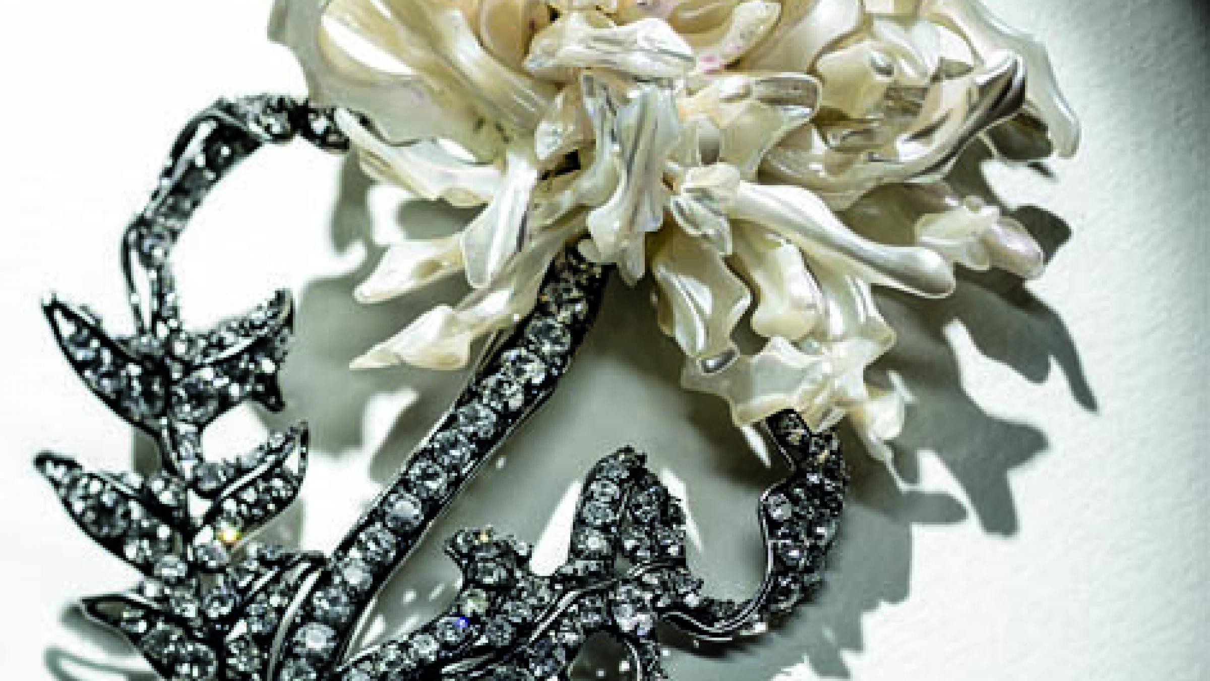 Iradj Moini, circa 1994,Floral brooch. Mother-of-pearl, Swarovski Austrian crystals. Gunmetal plated