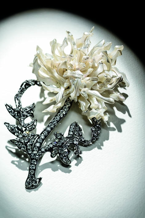 Iradj Moini, circa 1994,Floral brooch. Mother-of-pearl, Swarovski Austrian crystals. Gunmetal plated
