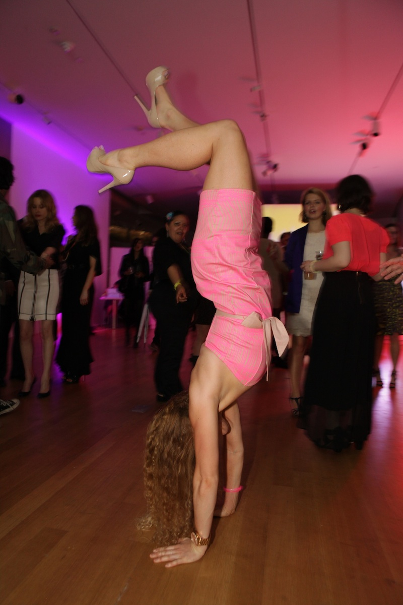 A partygoer enjoys some gymnastics at the FLUORESCENTBALL.