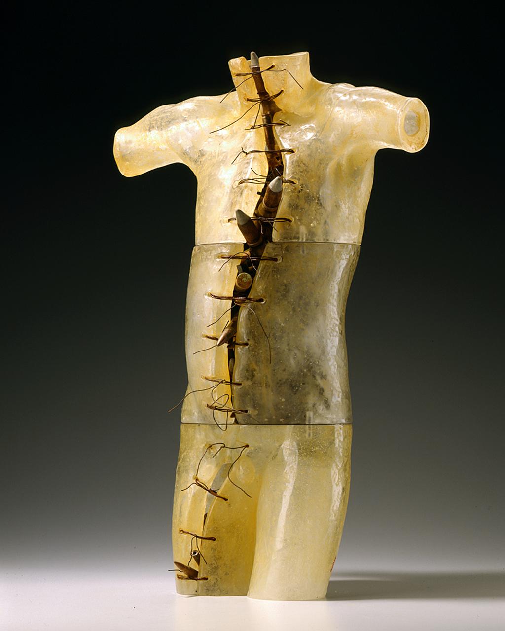 War Boy - Job No. 1, 2006: Clifford Rainey. Glass, inert ammunition, iron wire, oxides, pins, maple plinth. Photo: Lee Fatherree
