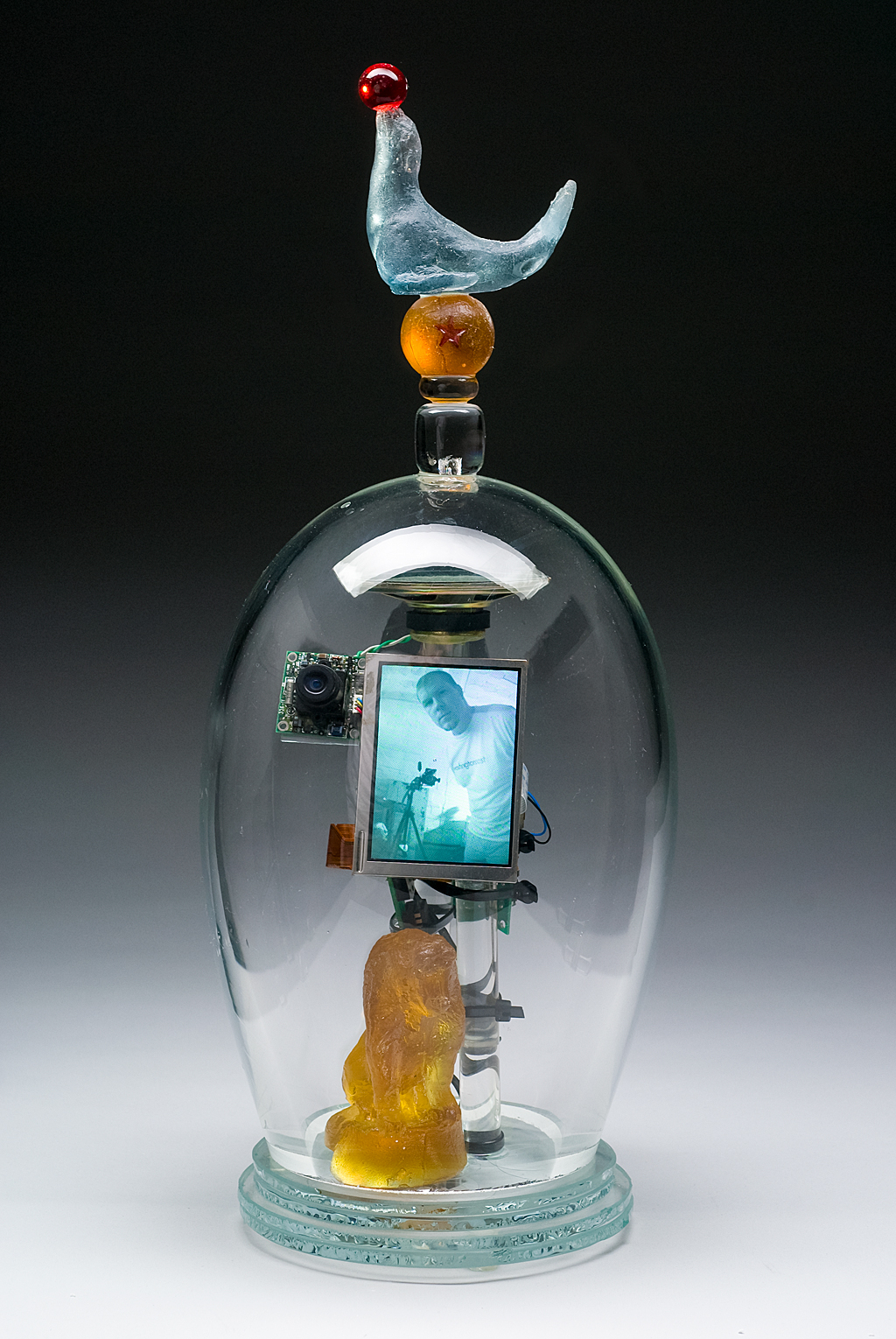 I Want To Run Away and Join the Circus, 2009: Tim Tate. Blown and cast glass, electronic components, original video. Photo:  Anything Photographic