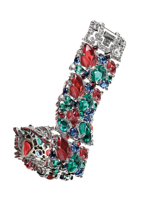 "Trifari (circa 1940s), United States: ""Fruit Salad"" bracelet. Molded glass, rhinestones, rhodium plated. Signed Trifari. Inspired by Cartier tutti-frutti jewelry. © Pablo Esteva"