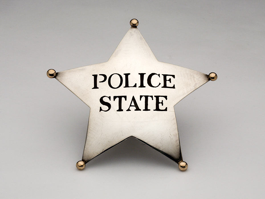 Police State Badge, 1969: William Clark; Sterling silver, 14k gold; Gift of Diane Kuhn, 2012, Photo by Velvet da Vinci Gallery