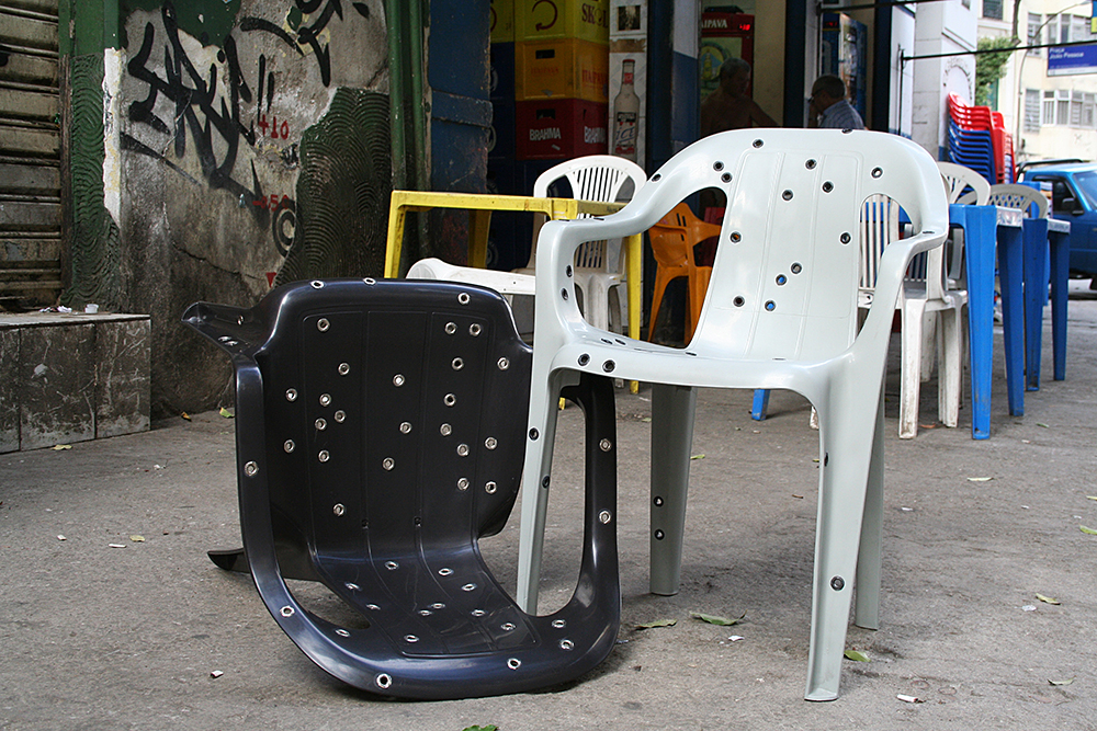 Design da Gema, Stray Bullet Chair (2011): Polypropylene monobloc chair, stainless steel eyelets. Courtesy of the artist. Brazil. Photo by David Elia.