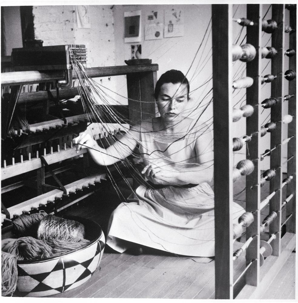 Lenore Tawney in her Coenties Slip studio, New York, 1958.: Courtesy of Lenore G. Tawney Foundation; Photo by David Attie