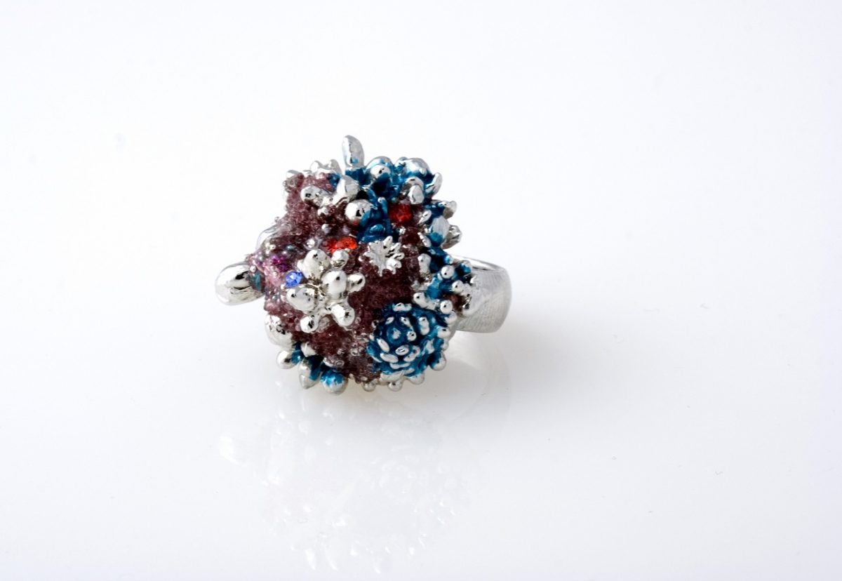 "Ruth Reifen: Supreme2; Rhodium plated copper, crystal, glass, automotive paint, enamel resin. Womens ring size: 7. Dimension: 1.5""1""x0.75"". 2013"